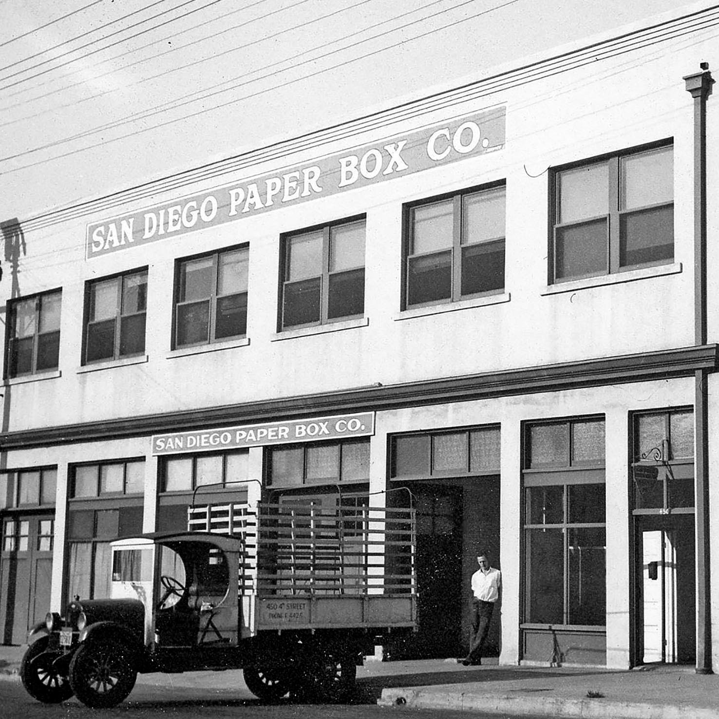 Historic storefront with truck